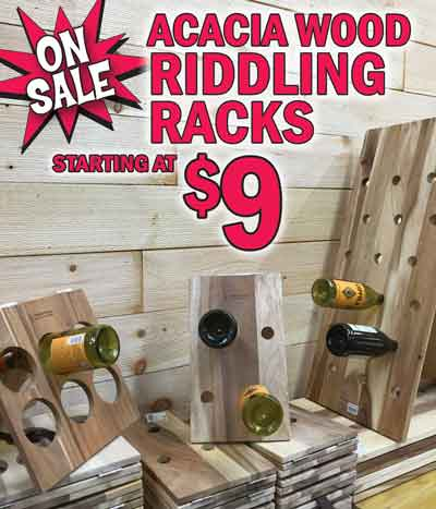 Acacia Wood Riddling Racks and Cutting Boards, and Mango Wood Candle Holders. Riddling Racks in 4 sizes - $9 to $19. Cutting boards in 3 sizes - $9 to $14. Candle Holders with mango wood bases and glass cups in 3 styles $3.99 to $4.99.
