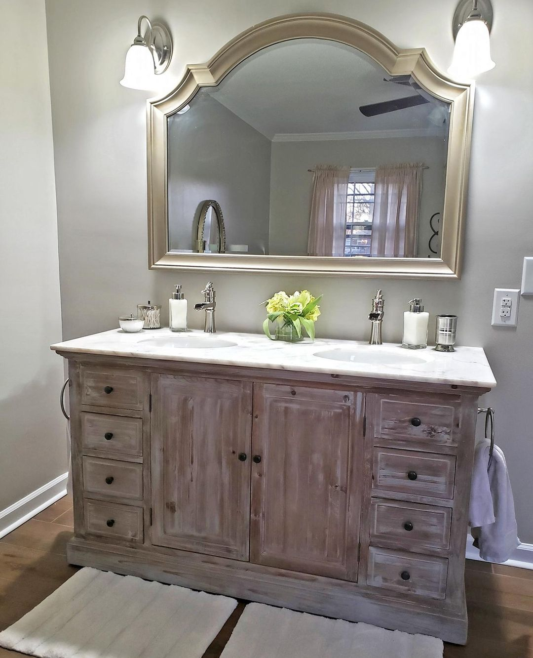 We love the rustic touch that our Reclaimed Wood Vanity adds to this bathroom.