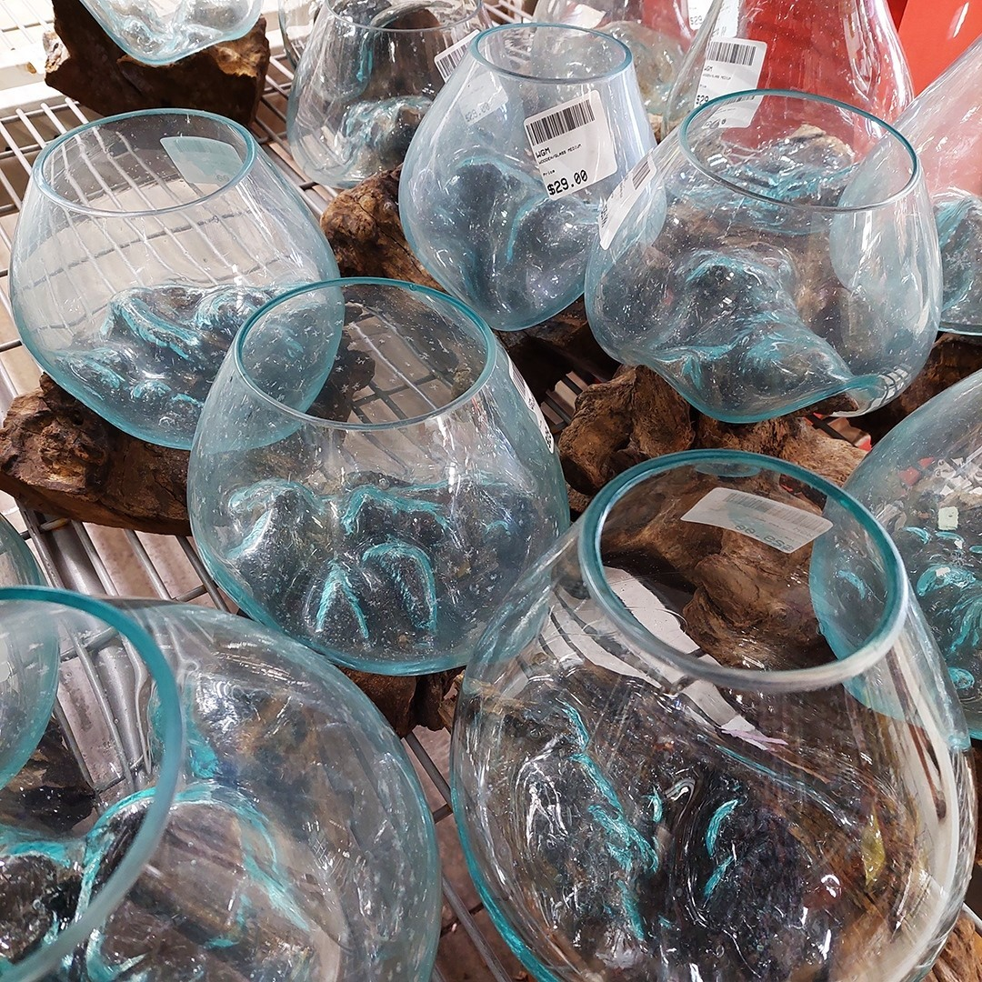 Fill these Molten Glass and Reclaimed Teak Vases with flowers, potpourri, or even succulents. Just $29 each.